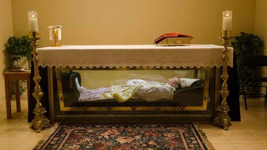 The remains of  Saint John Neumann are shown Tuesday, May 5, 2015, at the national shrines of St. John Neumann in Philadelphia. At the Neumann shrine, tucked in a commercial area in North Philadelphia, visitors can view remains of the saint, who was the fourth bishop of Philadelphia and is credited with expanding the Catholic education system in the U.S. (AP Photo/Matt Rourke)