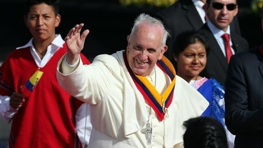 Pope Francis waves upon his arrival to the Mariscal Sucre International airport in Quito, Ecuador,  Sunday, July 5, 2015. History's first Latin American pope returns to Spanish-speaking South America for the first time on Sunday to visit Ecuador, Bolivia and Paraguay. (AP Photo/Fernando Llano)