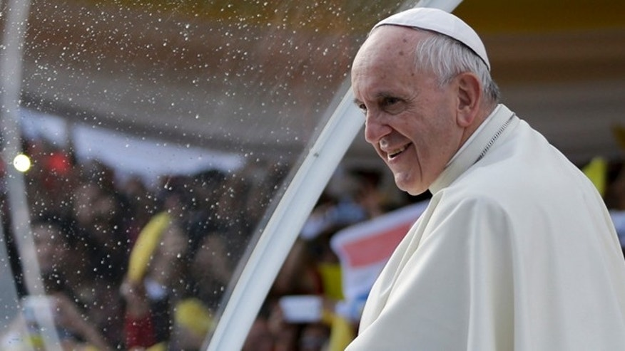 Pope Francis stands in his popemobile as he smiles at the crowds gathered in front of the women's prison, Buen Pastor in Asuncion, Paraguay, Friday, July 10, 2015. While in Paraguay, he will celebrate two Masses, including one in Caacupe, the center of Paraguayan spirituality. He'll also meet with President Horacio Cartes on Friday and with hundreds of local groups on Saturday. (AP Photo/Jorge Saenz)