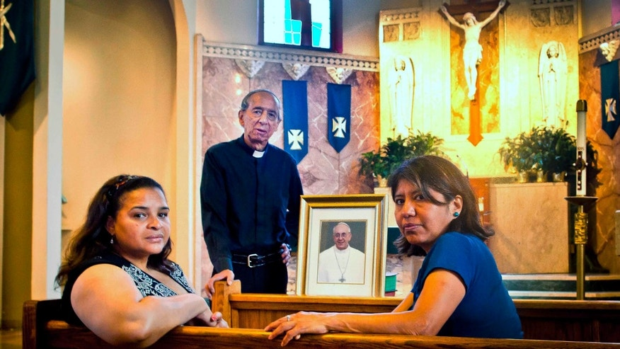 Maria Rodriguez, Father Diego Villegas and Alma Reyes at Queen's Saint Leo's church, in New York.