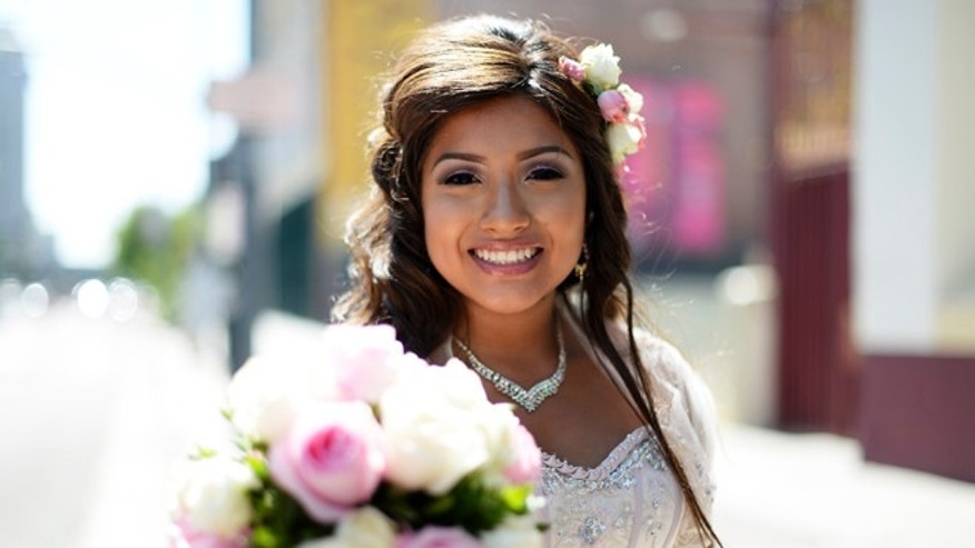 LOS ANGELES, CA - SEPTEMBER 14: Emily Desiree Mendez, 15, celebrates her quinceanera before taking part in the third annual Grand Marian European-style procession from La Placita to the Cathedral of Our Lady of the Angels in celebration of the 232nd anniversary of Los Angeles's founding September 14, 2013 in Los Angeles, California. The City of Los Angeles was founded by Spanish missionaries on September 4, 1781, and was christened El Pueblo de Nuestra Senora de Los Angeles in honor of Our Lady of the Angels. (Photo by Kevork Djansezian/Getty Images)