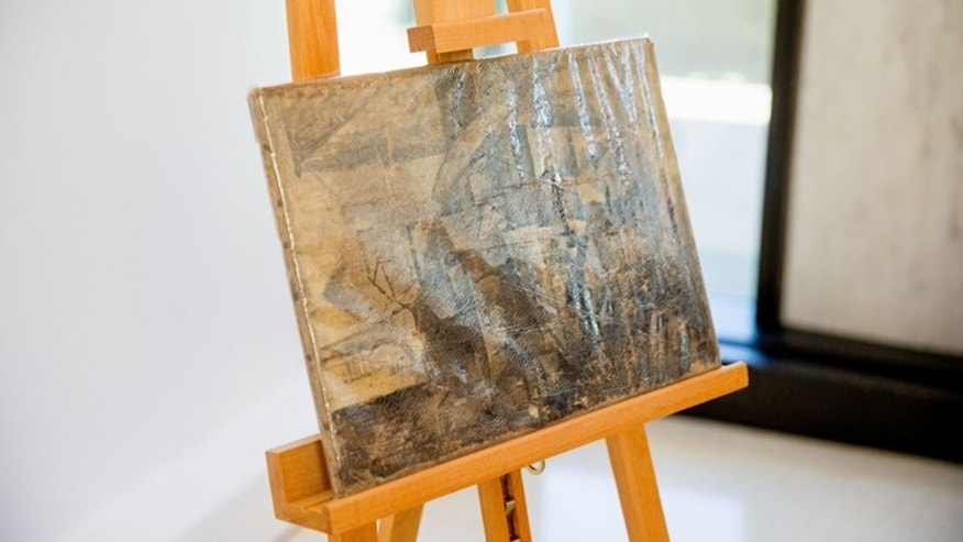 "Pablo Picasso's ""La Coiffeuse,"" seen in a protective plastic cover, is displayed at the French Embassy in Washington, Thursday, Aug. 13, 2015. The U.S. Immigration and Customs Enforcement returned the stolen painting, valued at $15 million, that was stolen in 1998 and was seized in December 2014. (AP Photo/Andrew Harnik)"
