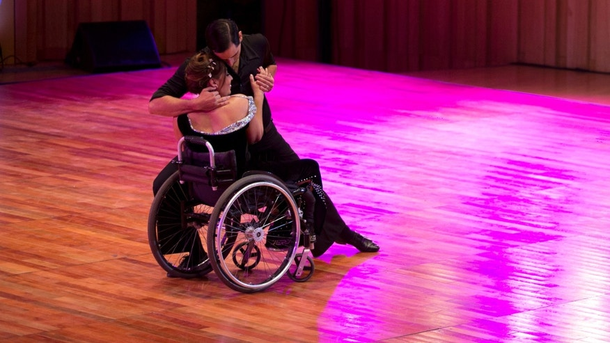Argentine dancers Gabriela Fernanda Torres and Pablo Rafael Pereyra, compete in the stage category at the World Tango Championship in Buenos Aires, Argentina, Friday, Aug. 21, 2015. Torres says she doesnât want special treatment, and hopes the judges to evaluate the couple as artists. If they are chosen, they will move on to the semi-finals. (AP Photo/Natacha Pisarenko)