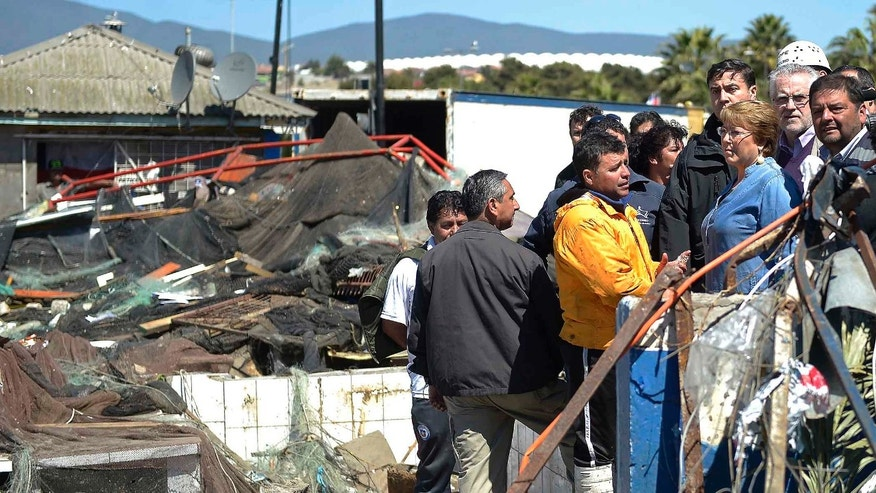 President of Chile Michelle Bachelet inspects the earthquake damage in the costal town of  Coquimbo, Sept. 17, 2015.