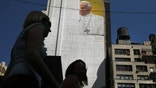 NEW YORK, NY - AUGUST 28:  A partially completed mural of Pope Francis is viewed on the side of a building in midtown Manhattan on August 28, 2015 in New York City. The Pope will be making his first trip to the United States on a three-city, five-day tour that will begin in Washington on September 22, then travel to New York City and Philadelphia. The Pope will depart on September 27.  (Photo by Spencer Platt/Getty Images)