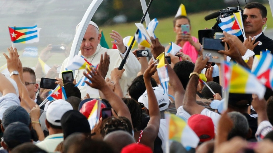Pope Francis arrives for Mass at Revolution Plaza in Havana, Cuba, Sunday, Sept. 20, 2015. Pope Francis opens his first full day in Cuba on Sunday with what normally would be the culminating highlight of a papal visit: Mass before hundreds of thousands of people in Havana's Revolution Plaza. (AP Photo/Desmond Boylan)