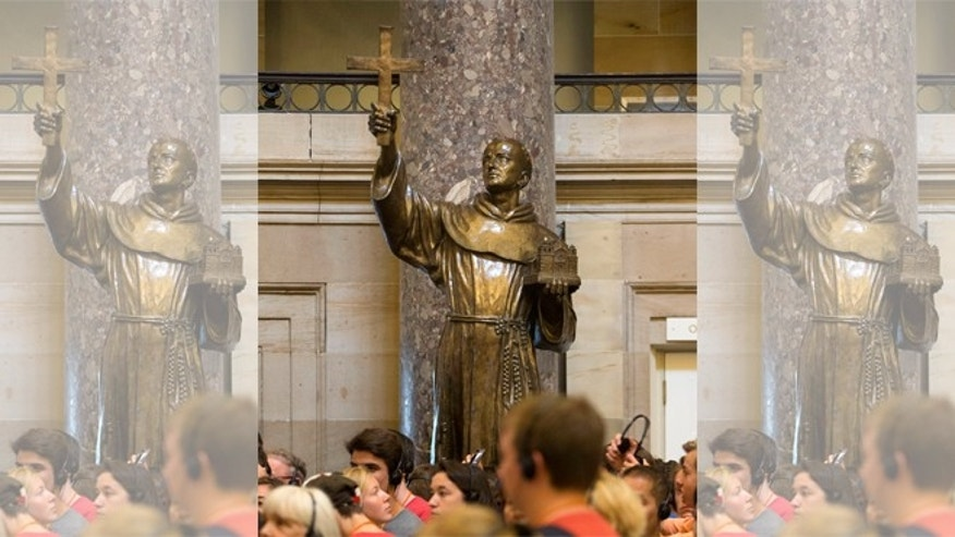 In this July 2, 2015, file photo, Capitol Hill visitors walk in front of a statue of missionary Junipero Serra, center, located in Statuary Hall, also known as the Old Hall of the House, on Capitol Hill in Washington. The first pope from the Americas is preparing to elevate to sainthood an 18th-Century missionary who brought Catholicism to California. Pope Francis will canonize Junipero Serra during a Mass on Sept. 23 outside the Basilica of the National Shrine of the Immaculate Conception in Washington.(AP Photo/Pablo Martinez Monsivais, File)