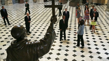 WASHINGTON, DC - SEPTEMBER 16:  House Speaker John Boehner (R-OH) (C) participates in a walk through of Statuary Hall in front of the Blessed Junipero Serra statue thatÊPope Francis will canonize during his visit to the CapitolÊSeptember 16, 2015 in Washington, DC. Next week Pope Francis will be visiting the United States and will speak before a joint meeting of Congress.  (Photo by Mark Wilson/Getty Images)