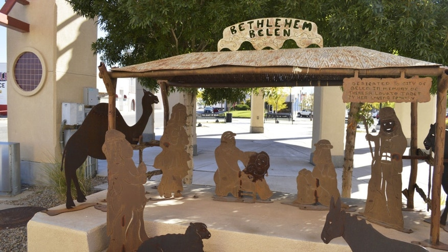 A Nativity scene in Belen, N.M., is displayerd next to City Hall Tuesday, Oct. 13,2015, where it has been since 1992. The little town of Belen  Spanish for Bethlehem  is fighting to keep the all-year round Nativity scene on city property, despite objections from a Wisconsin-based organization who that wants it removed over church-state concerns. (AP Photo/Russell Contreras)