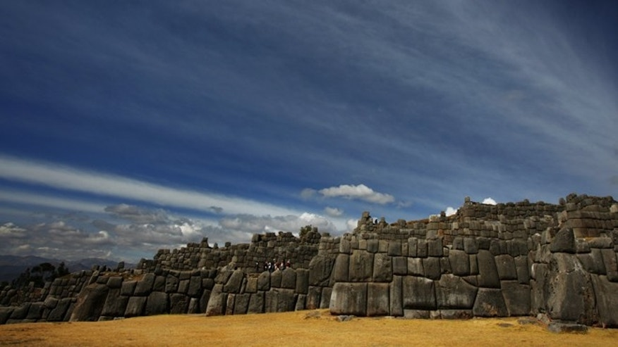 CUZCO, PERU - JUNE 2007: Images of enormous rock structures at Sacsayhuaman, an ancient Inca ground overlooking Cuzco, Peru, 23 June 2007. The Inti Raymi festival is the most spectacular Andean festival with over 500 actors re-enacting the the ceremony of adoration of the Sun God, personified by the Inca. Thousands of people fill the great square of the fortress of Sacsayhuaman to re-enact the ceremony. The festival brings together all the different Andean communities and provides an opportunity for these communities to come together. (Photo by Brent Stirton/Getty Images.)