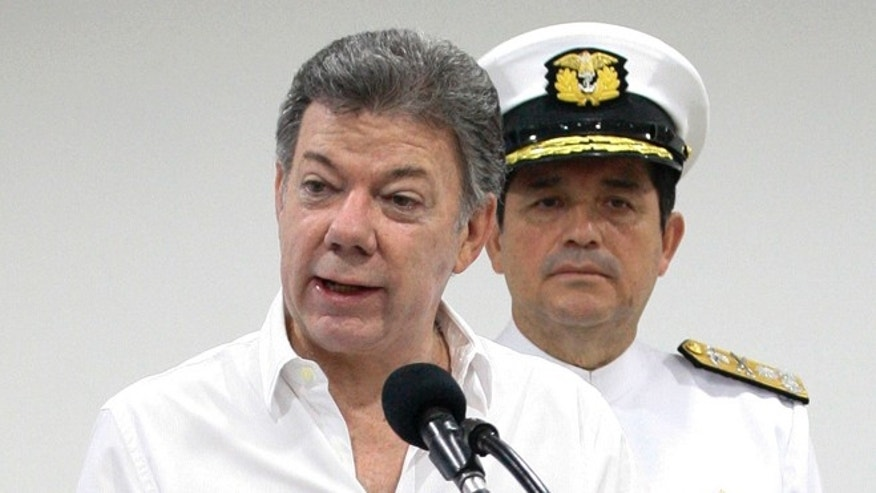 Colombia's President Juan Manuel Santos talks to the media during a press conference in Cartagena, Colombia, Saturday, Dec.5, 2015. Santos announced the discovery of the remains of the Galleon San Jose, a Spanish boat eighteenth century empire that sank in the Caribbean Sea loaded with gold. (AP Photo/ Pedro Mendoza)