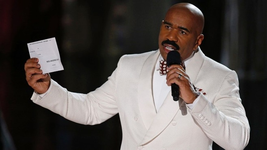 Steve Harvey holds up the card showing the winners after he incorrectly announced Miss Colombia Ariadna Gutierrez at the winner at the Miss Universe pageant Sunday, Dec. 20, 2015, in Las Vegas. According to the pageant, a misreading led the announcer to read Miss Colombia as the winner before they took it away and gave it to Miss Philippines Pia Alonzo Wurtzbach.(AP Photo/John Locher)