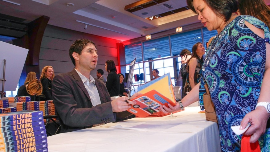 Author Matt De La Pena in a book signing on April 16, 2015 in New York City.