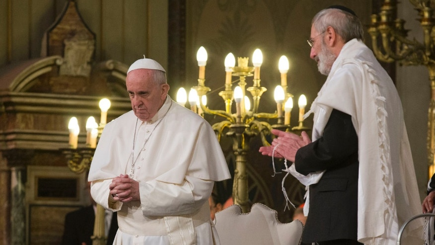 Pope Francis flanked by Rabbi Riccardo Di Segni, right, during his visit to the Great Synagogue of Rome, Sunday, Jan. 17, 2016. Pope Francis made his first visit to a synagogue as pope Sunday, greeting Rome's Jewish community in their house of worship as his two predecessors did in a show interfaith friendship at a time of religiously-inspired violence around the globe. (AP Photo/Alessandra Tarantino)