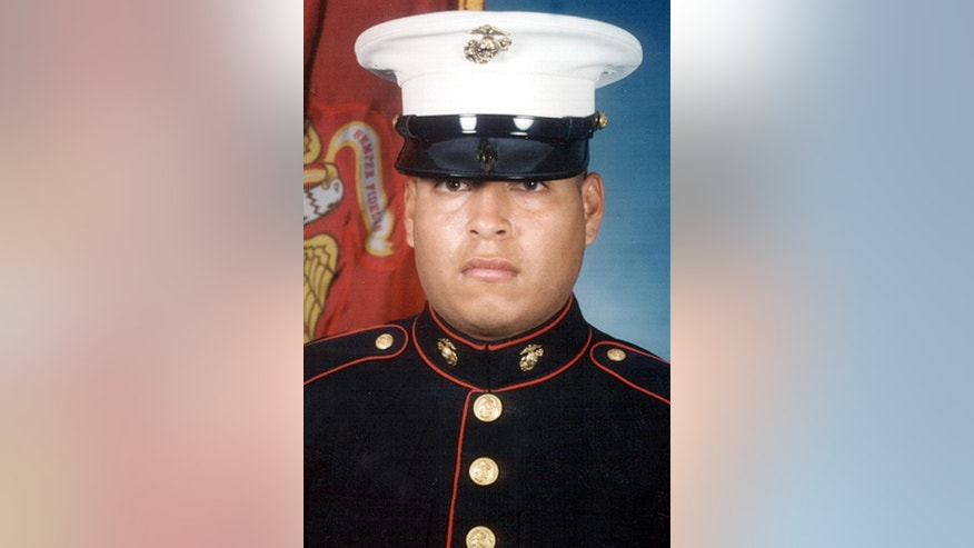 This undated file photo provided by the U.S. Navy shows Marine Sgt. Rafael Peralta.