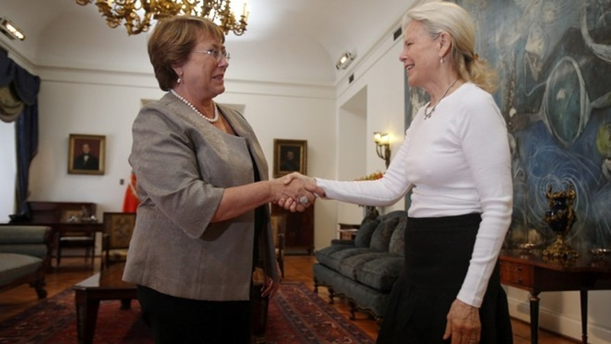 Kristine McDivitt Tompkins, widow of late American conservationist Doug Tompkins, left, shakes hands with Chile's President Michelle Bachelet at La Moneda Palace in Santiago, Chile, Thursday, Jan. 21, 2016. McDivitt Tompkins said that since her husband died last month while kayaking in South Americas Patagonia region at age 72, she has been working non-stop to permanently protect from future development the millions of acres they acquired over a quarter-century. (AP Photo/Luis Hidalgo)
