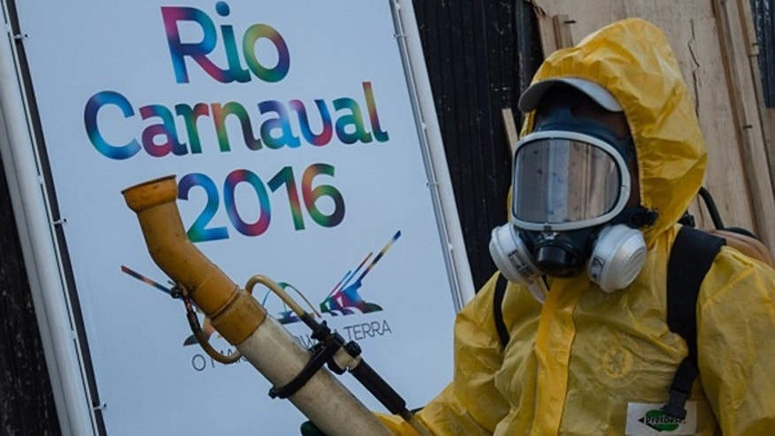 "A municipal agent sprays anti Zika mosquitos chimical product at the sambadrome in Rio de Janeiro, on January 26, 2016. Brazil is mobilizing more than 200,000 troops to go ""house to house"" in the battle against Zika-carrying mosquitoes, blamed for causing horrific birth defects in a major regional health scare, a report said Monday. / AFP / CHRISTOPHE SIMON        (Photo credit should read CHRISTOPHE SIMON/AFP/Getty Images)"