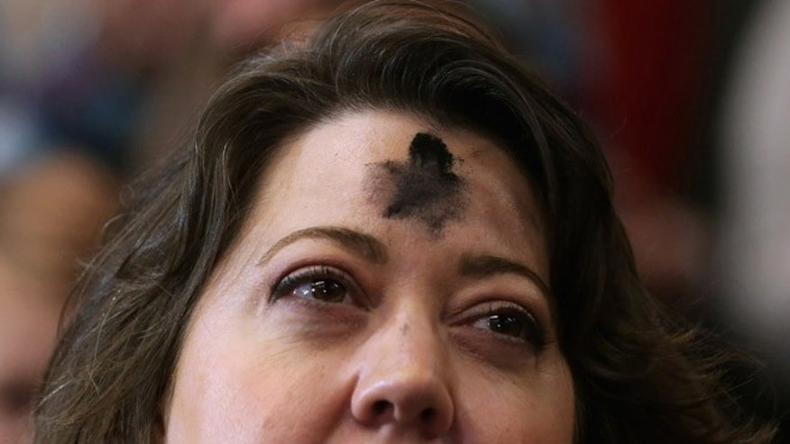 COLUMBIA, SC - FEBRUARY 10:  A woman with a cross on his forehead for Ash Wednesday listens to Republican presidential candidate Sen. Marco Rubio (R-FL) during a campaign rally at the Columbia Metropolitan Convention Center February 10, 2016 in Columbia, South Carolina. Rubio placed fifth in the New Hampshire primary, behind fellow GOP candidates Jeb Bush, John Kasich, Sen. Ted Cruz (R-TX) and Donald Trump, who won with 35 percent of the vote.  (Photo by Chip Somodevilla/Getty Images)