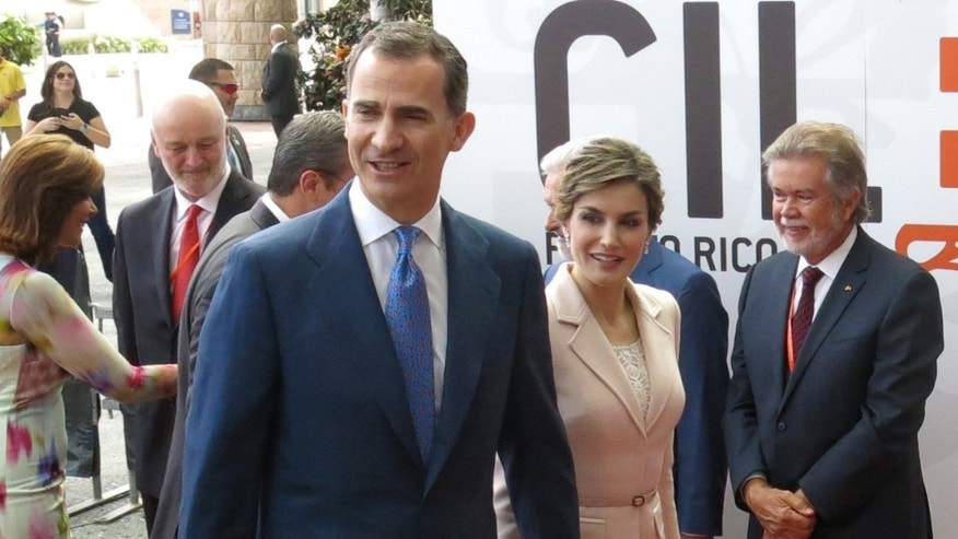 King Felipe VI and Queen Letizia of Spain arrive at the Royal Spanish Academy's weeklong conference in San Juan, Puerto Rico, Tuesday, March 15, 2016. The royal couple joined more than 200 writers, academics and experts who traveled to the U.S. territory to discuss in part the challenges the Spanish language faces. The organization meets every three years and regulates a language spoken by more than 500 million people. (AP Photo/Danica Coto)