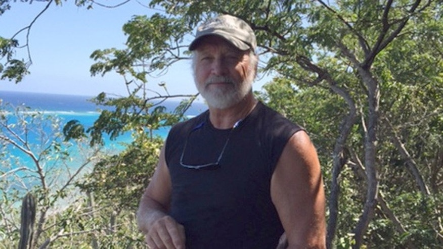 In this March 6, 2015, photo provided by Donna Thompson, shows her husband David Thompson at Virgen Gorda, British Virgin Islands. David Thompson, a retired engineer from Kalamazoo, Michigan, managed to swim seven hours through rough water to reach land in Puerto Rico after being tossed overboard on Sunday, March 13, 2016, from his sailboat en route to South Florida. (Donna Thompson via AP)