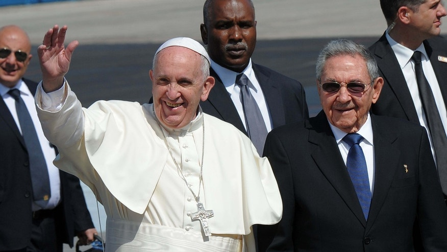 Pope Francis (L) is welcomed by Cuban President Raul Castro at the International Airport Jose Marti in Havana, on February 12, 2016. Pope Francis landed in Cuba Friday to meet with the head of the Russian Orthodox Church, the first such encounter since the two branches of Christianity split a millennium ago. The 79-year-old pontiff, in his white robes, stepped off an Alitalia plane and shook hands with Cuban President Raul Castro on the tarmac at Jose Marti airport, where he was then due to sit down with the Russian Patriarch Kirill.   AFP PHOTO / YAMIL LAGE / AFP / YAMIL LAGE        (Photo credit should read YAMIL LAGE/AFP/Getty Images)