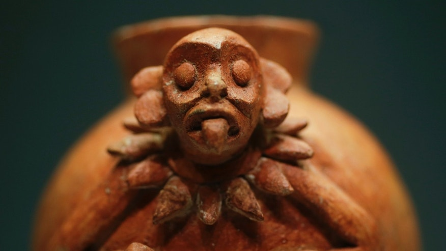 A pot with a monkey, 900-1250 AD, at the 'The Maya  Language of Beauty at the Martin-Gropius-Bau' museum in Berlin.