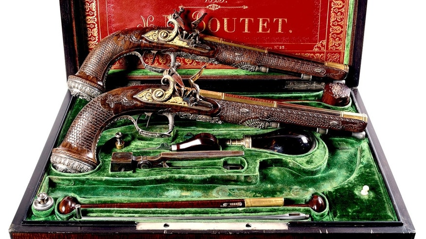 This photo provided by Christies on Thursday, April 7, 2016 shows a pair of pistols gifted by Gen. Gilbert Motier, Marquis de Lafayette, to Simon Bolivar in 1825. The auction house is scheduled auction the items on Wednesday, April 13, 2016. (Christie's via AP)