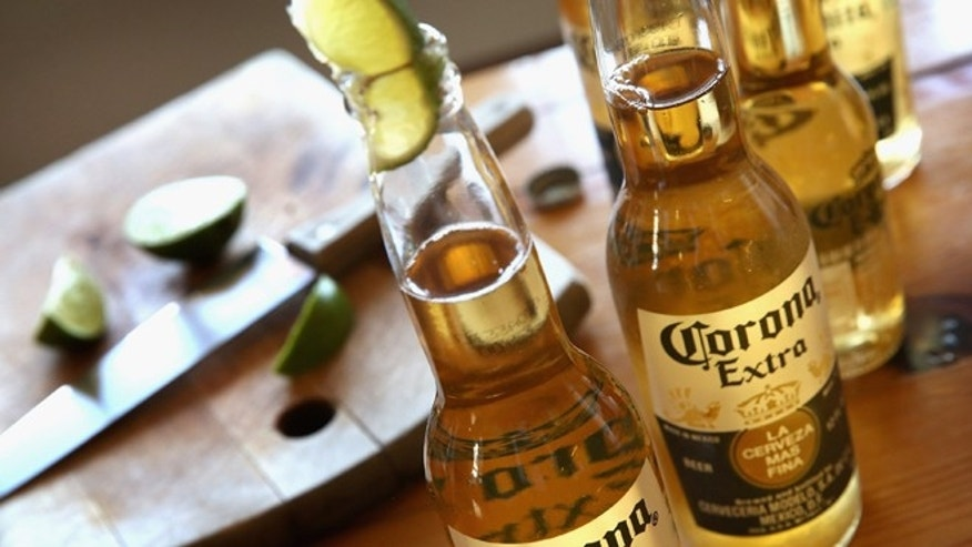 CHICAGO, IL - JUNE 07:  In this photo illustration, bottles of Corona beer are shown on June 7, 2013 in Chicago, Illinois.  Constellation Brands, one of the world's largest wine companies, is expected to become the third-largest beer supplier in the United State today with a $5.3 billion purchase of the U.S. distribution rights of Grupo Modelo beers from Anheuser Busch InBev. Corona Extra, brewed by Grupo Modelo, is the number one selling imported beer sold in the United States and the number six selling beer overall.  (Photo Illustration by Scott Olson/Getty Images)