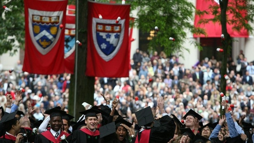 CAMBRIDGE, MA - JUNE 5:  Harvard University Medical School graduates celebrate at commencement ceremonies by tossing 'giant pills' in the air June 5, 2008, in Cambridge, Massachusetts. J.K.Rowling, who wrote the popular Harry Potter books, was the commencement speaker.  (Photo by Robert Spencer/Getty Images)