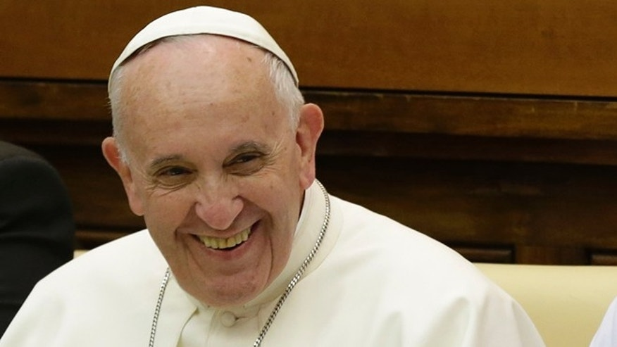 Pope Francis smiles as he arrives to attend a two-day summit of judges and magistrates against human trafficking and organized crime, at the Vatican, Friday, June 3, 2016. Judges and prosecutors from around the world are pledging to crack down on human trafficking and help victims of modern-day slavery in the latest Vatican initiative to draw attention to the problem and rally resources to fight it. (AP Photo/Gregorio Borgia)