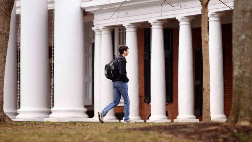 CHARLOTTESVILLE, VA - DECEMBER 6:  Garrett Durig, a fourth year student at the University of Virginia, walks across campus on December 6, 2014 in Charlottesville, Virginia. On Friday, Rolling Stone magazine issued an apology for discrepencies that were published in an article regarding the alleged gang rape of a University of Virginia student by members of the Phi Kappa Psi fraternity. (Photo by Jay Paul/Getty Images)