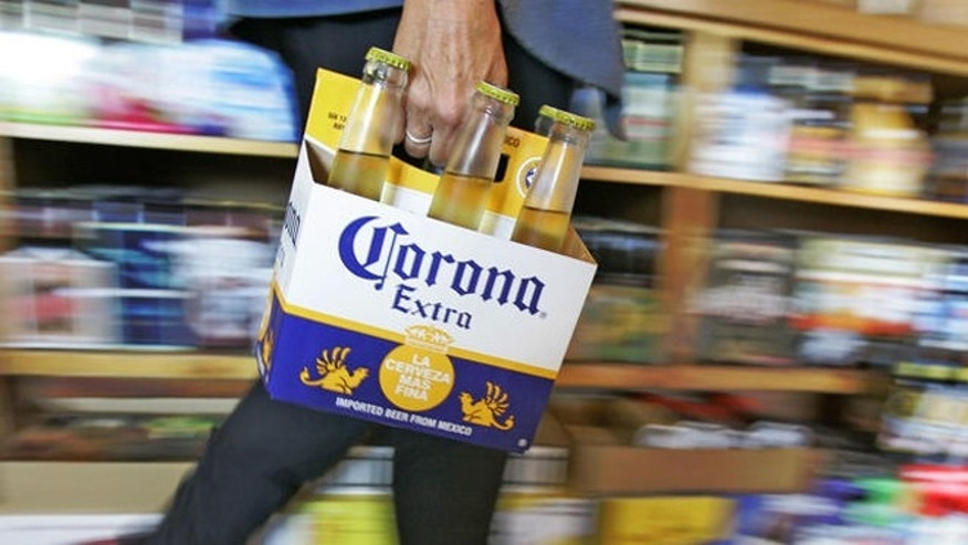 A customer carries a six-pack of Corona beer, a Constellation Brand, through Chuck's Beverage store in Chagrin Falls, Ohio on Thursday, Oct. 5, 2006. Beer, liquor and wine producer Constellation Brands Inc. said its second-quarter profit fell 18 percent due to higher costs and restructuring charges, and it revised fiscal 2007 guidance to reflect intense competition in the British market. (AP Photo/Amy Sancetta)