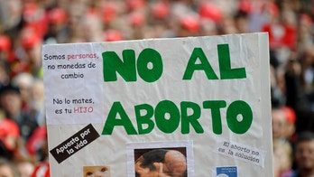 MADRID, SPAIN - MARCH 29:  A placard reads 'No to abortion' during a church backed anti-abortion demonstration on March 29, 2009 in Madrid, Spain. A new abortion proposal by Spain's Socialist government has angered the conservative clergy breaking a delicate truce between anti-abortion activists and women's groups in Catholic Spain. The new abortion law is expected to be approved by parliament before the summer which would allow the procedure up to 22 weeks with a doctor's certificate.  (Photo by Jasper Juinen/Getty Images)