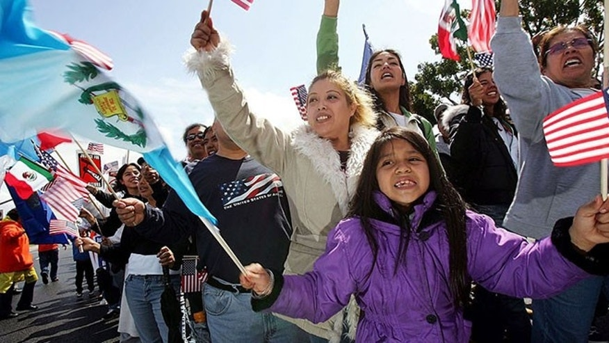 COSTA MESA, CA - APRIL 01:  Seven-year-old April Palazios, whose parents came from Guatemala, waves Guatemalan and US flags as protesters march to decry pending federal legislation aimed at reducing illegal immigration on April 1, 2006 in Costa Mesa, California. An estimated 1,500 to 2,000 people participated in today's demonstration including members of the Mexican American Political Association, Hermandad Mexicana Latino Americana, and Service Employees International Union participated in the rally.  (Photo by David McNew/Getty Images)
