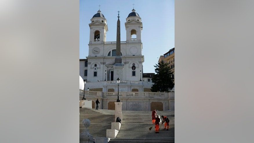 Workers give the final clean to the world-famous Spanish Steps before the start of a press conference to present the reopening of the site at the end of a 10-month restoration in which Bulgari jewelry house participated, in Rome, Thursday, Sept. 22, 2016. The Spanish Steps will open again to the public on Friday. (AP Photo/Andrew Medichini)