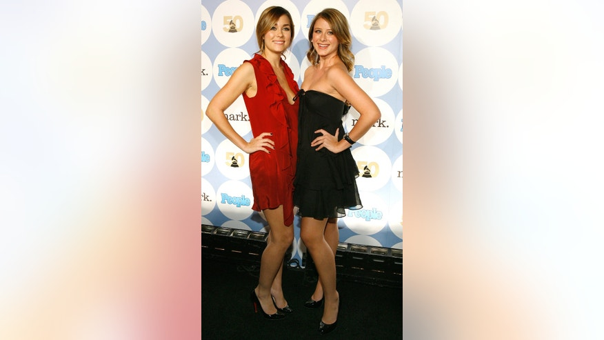 "Actresses Lauren Conrad (L) and Lauren ""Lo"" Bosworth pose at 50th annual Grammy Awards kick-off party in Hollywood, California on December 6, 2007."