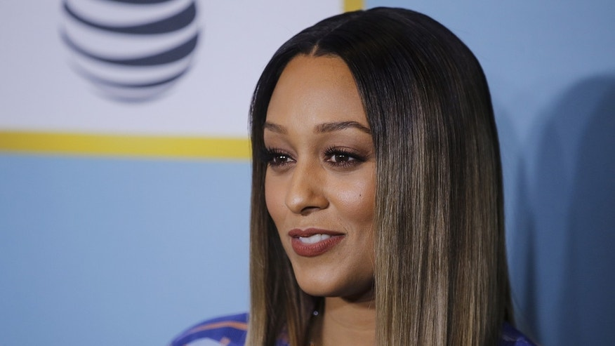 Actress Tia Mowry arrives for the Essence Black Women in Hollywood luncheon in Beverly Hills, February 25, 2016.