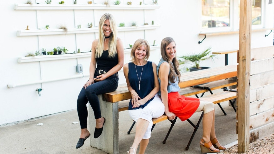 LSK Foundation co-founders Lauren Scruggs Kennedy and Lisa Curlee, and director Ashley Igo, pose for a photo.