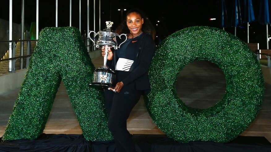 Tennis - Australian Open - Melbourne Park, Melbourne, Australia - early 29/1/17 Serena Williams of the U.S. poses with the Women's singles trophy after winning her final match.