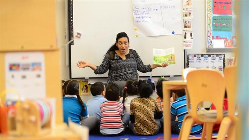 Dec. 10, 2015: A pre-K teacher reads to her class at Madison K Center in Paterson, N.J.