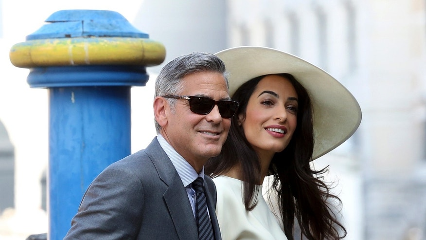 September 29, 2014. George Clooney and his wife Amal Alamuddin arrive at Venice city hall for a civil ceremony to formalize their wedding in Venice.