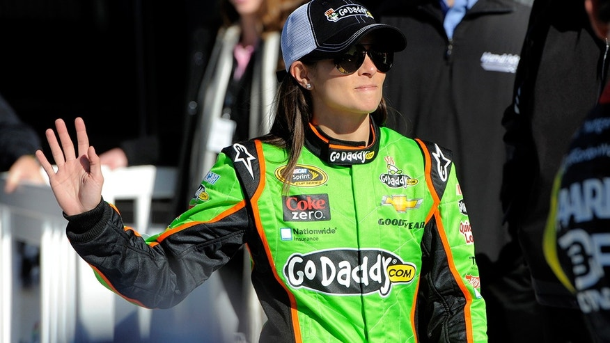 "NASCAR driver Danica Patrick posted a photo of her ""real"" vs. ""produced"" abs"