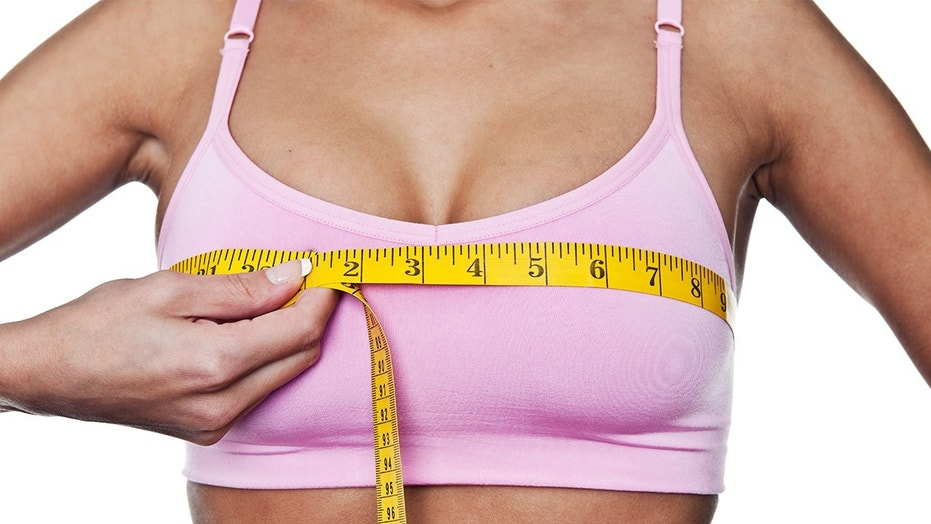 A bikini competitor felt pressured to get breast implants because everyone else had them