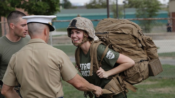 Model And Actress Kate Upton Tries On A Marine Ruck To Raise Awareness For Week