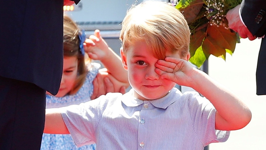 The shorts-loving royal tot is sure to feel right at home in his new school uniform.