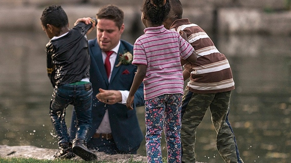 A groom in Canada is being called a hero after he saved a little boy from drowning during his wedding photo shoot