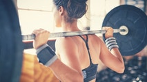 lifting weights istock