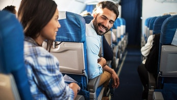 couple on plane istock