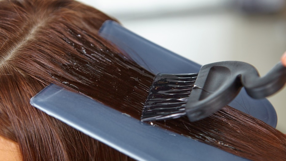 A student experienced burns and painful rashes after her school forced her to dye her hair.
