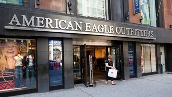 New York, New York, USA - October 2, 2011: A woman exits an American Eagle Outfitters store on 34th street in New York City. American Eagle Outfitters is a large chain offering men\'s and women\'s clothing and accessories.